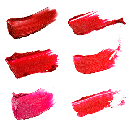 Collage of decorative cosmetics  color brush lipstick strokes on white background. Beauty and makeup concept.Beauty industry.