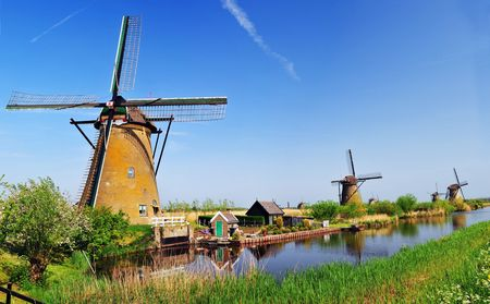 Windmill on the background the blue sky in Kinderdijk, Holland