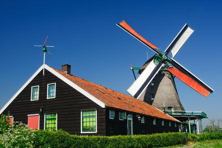 traditional Dutch windmill with open red and white sails. Zaanse Schans, the Netherlands Stock Photo - 6494606