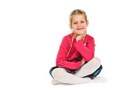 cross leg: ni�a en una blusa Rosa, sentada con las piernas cruzadas  Foto de archivo