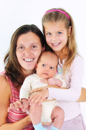 Portrait of happy young mother with her daughter and newborn son photo
