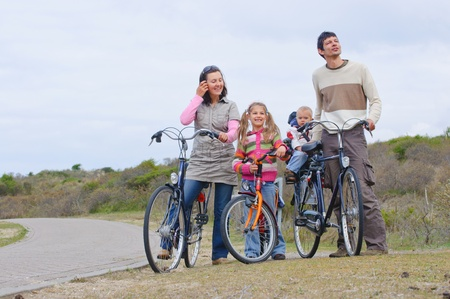 A family with children on their bikes photo