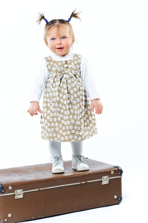 valise: Cute baby Girl In Fashionable Outfit and valise