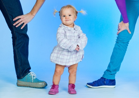 Cute baby Girl In Fashionable Outfit with parents Stock Photo - 9200226