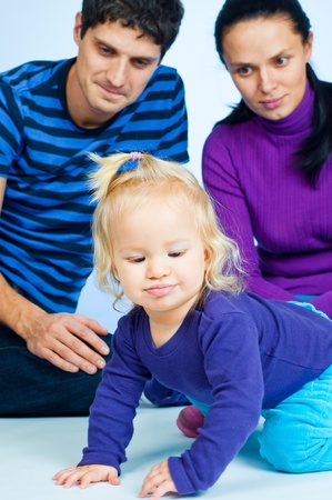Cute baby Girl In Fashionable Outfit with parents Stock Photo - 9200228