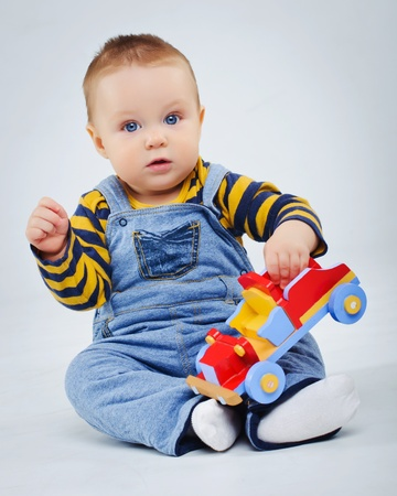 baby boy plaing his toy car Stock Photo - 9228391