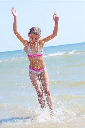 Happy Pretty beautiful girl running on beach Stock Photo - 9228394