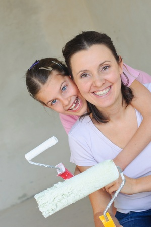 Mother and douther painting a wall with roller Stock Photo - 9275095