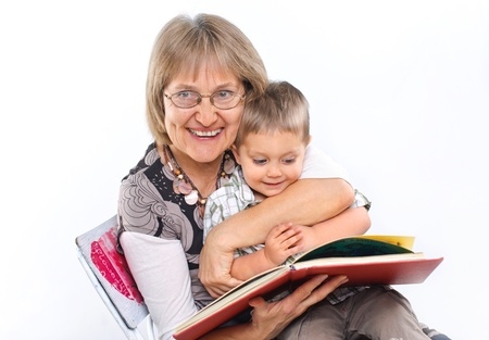 Grandmother and grandson reading a book photo