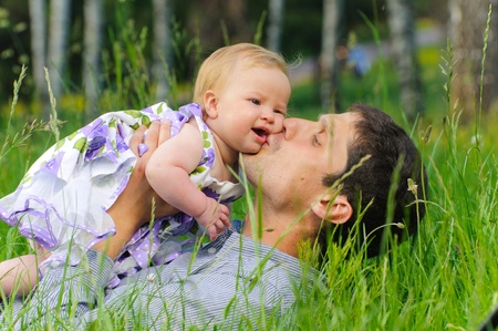 Happy father with daughter resting in the grass Stock Photo - 9360771