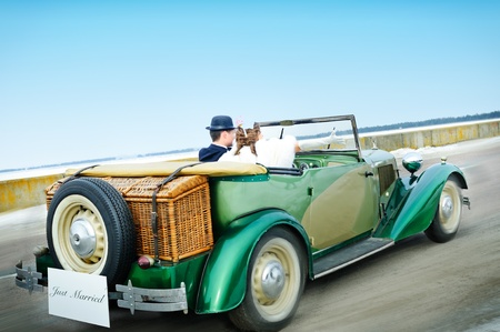 Newlyweds In Wedding Car