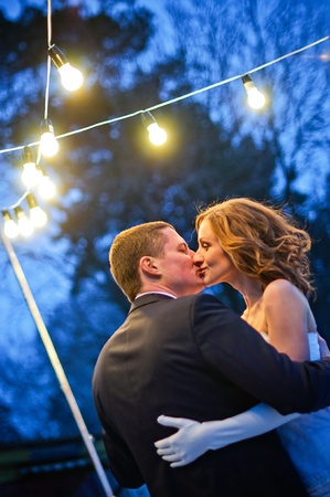 city lights: Newlyweds. Romantic Honeymoon dance with lanterns
