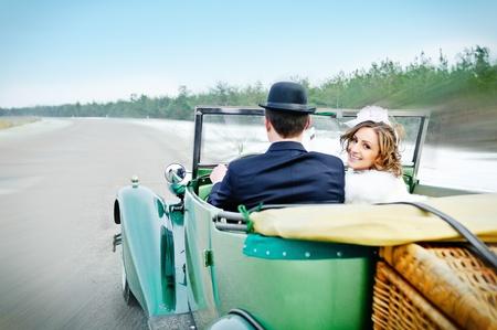 Newlyweds In Wedding Car photo