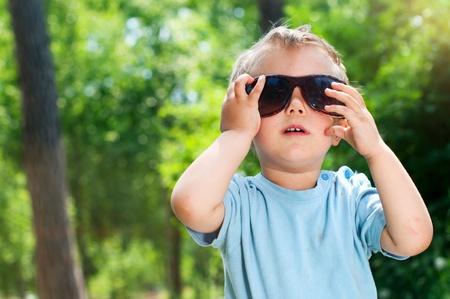 Boy in the summer park photo