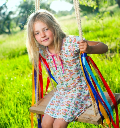 5 year old: Young girl on swing Stock Photo