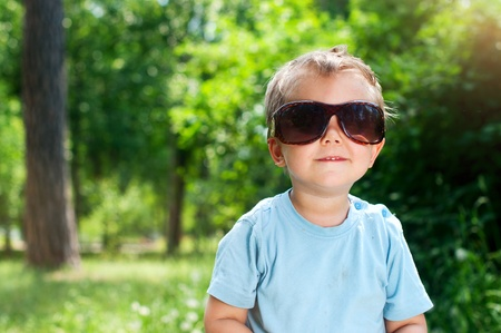 Boy Sunglasses in the summer park photo