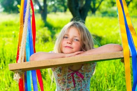 Young girl on swing photo