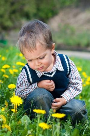 Boy With Dandelion photo