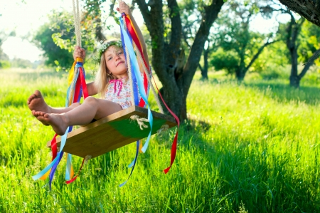 to believe: Young girl on swing Stock Photo
