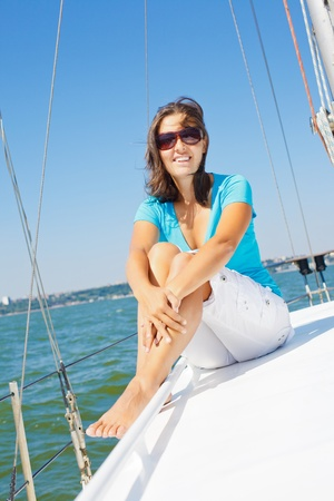Young girl sitting on a yacht photo