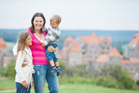 single parent: Travelers. Young mother with her two children Stock Photo