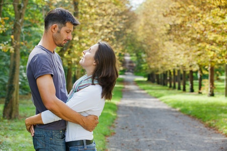 Young Couple Walking in autumn park photo