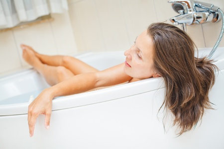 Beautiful lady in the bath photo