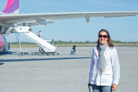 beautiful woman tourist prepared to fly photo