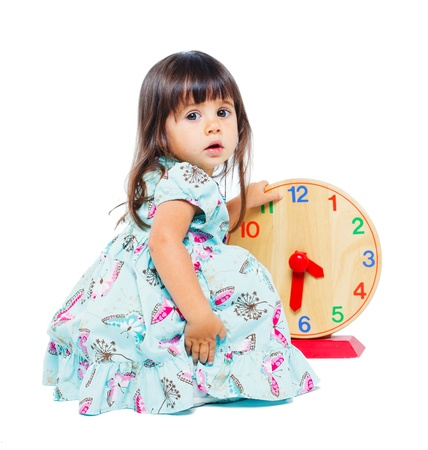 Pretty little girl with clock photo