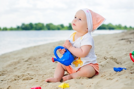 Little cute girl on the beach photo