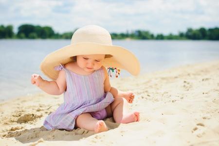 sun hat: Little cute girl on the beach