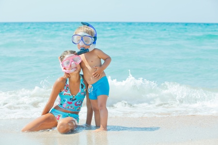 kids playing beach: Happy Divers On A Beach Stock Photo