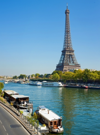 eiffel tower: View of a living barge on the Seine in Paris