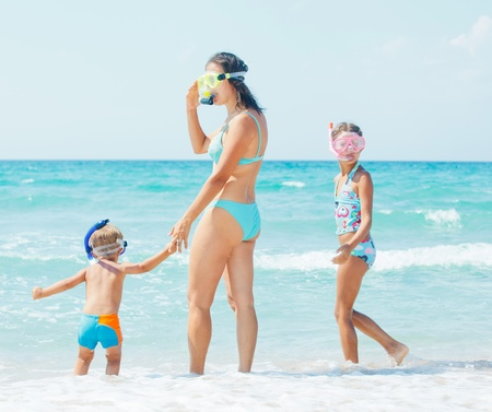 Happy family snorkeling  photo
