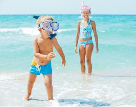 sky dive: Happy children on beach
