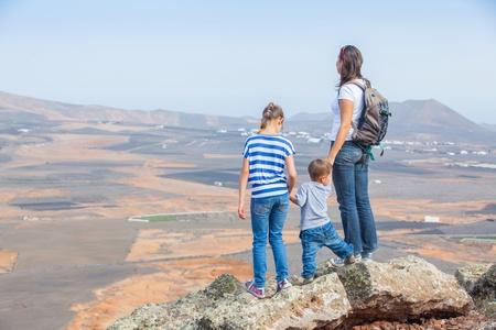 Mother and her child standing on cliffs edge photo