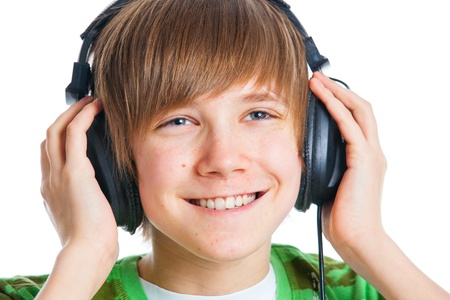 portrait of a male teenager listening to music photo