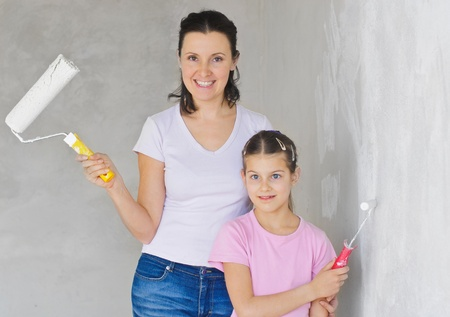 douther: Happy Mother and douther painting a wall