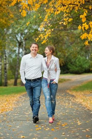 Romantic young beautiful couple on autumn walk photo