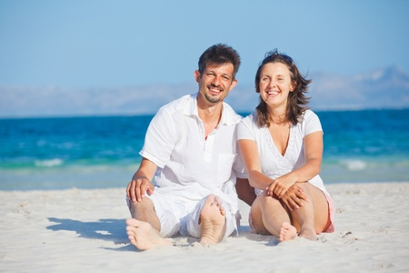 destination wedding: Happy young couple on the beach