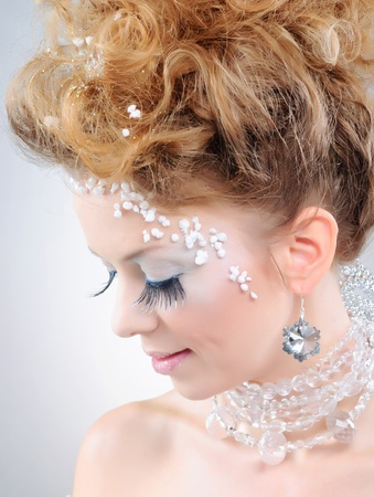 Closeup portrait of beautiful girl with makeup photo