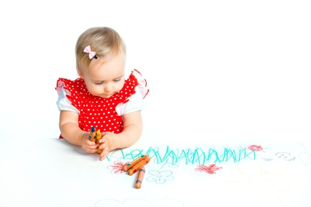 little girl drawing with crayons photo