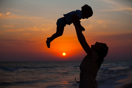 Mother and little son silhouettes photo