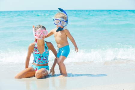 snorkelers: Happy Divers On A Beach Stock Photo
