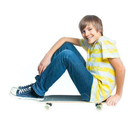 pre teen: blond boy on sitting on skateboard