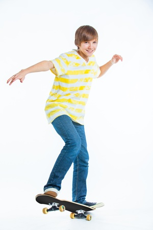 blond boy on standing on skateboard photo