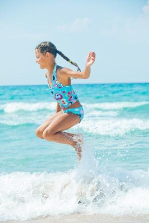 10 12 years: Cute girl on the beach Stock Photo