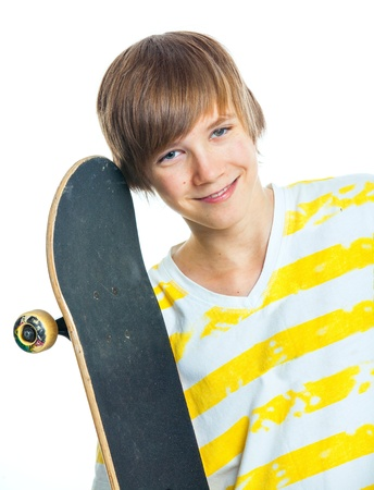 Portrait blond boy with skateboard photo