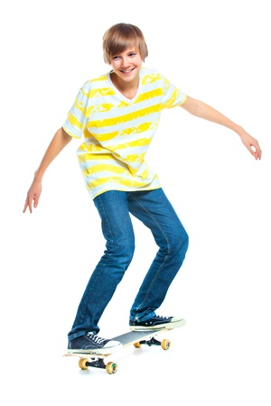 pre adolescents: blond boy on standing on skateboard Stock Photo