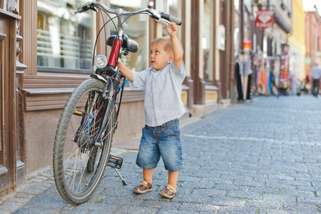 small town: cute little boy with big bike